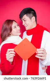 couple show couplets with chinese new year on red background