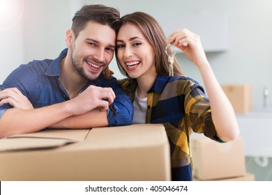 Couple showing keys to new home