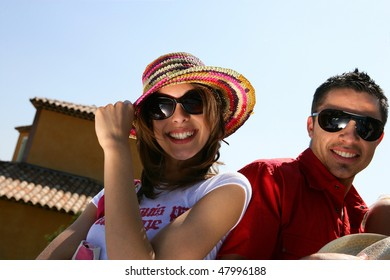 Couple showing off with sunglasses and hat on