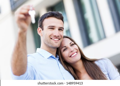 Couple showing their new house keys