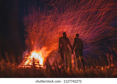 Couple silhouette by the fire - romantic valentine photo full of love