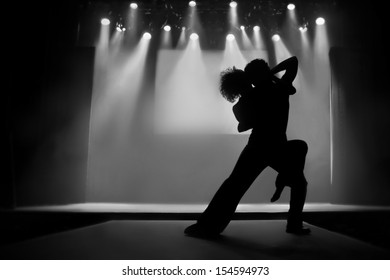 Couple in silhouette dancing on a stage - Black and White picture