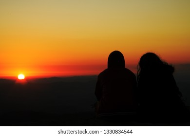Couple silhouette at sunrise in Brazil