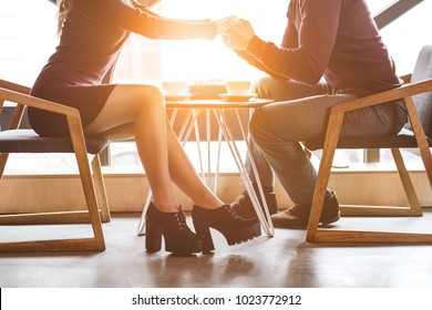 The couple sit at the restaurant table