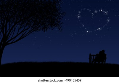A couple sits on a bench near a tree under the starry night sky. Directly overhead a group of stars make a heart shape in the sky.
