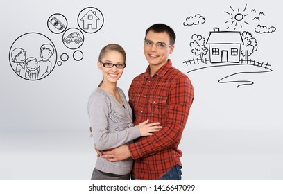 Couple sitting back-to-back dreaming with doodle pictures