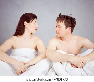 a couple sitting in bed