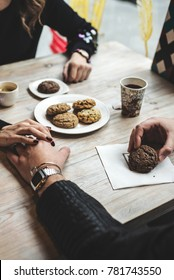Couple sitting in Caffe and eat cookies