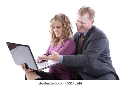 A couple is sitting with a computer and smiling at what they see.