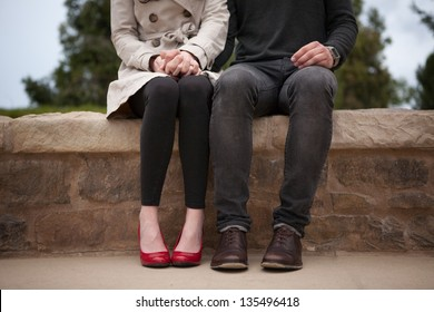 Couple sitting and holding hands
