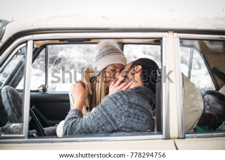 people kissing in the car