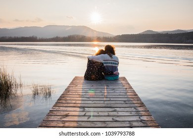 Couple sitting on a footbridge