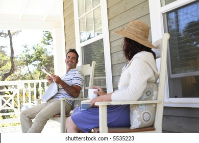 Couple sitting on front porch