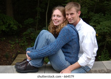 Couple sitting on a ledge