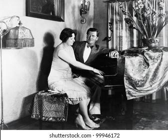 Couple sitting at piano