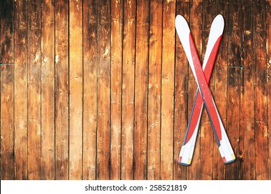 Couple of ski hanging on a wooden wall