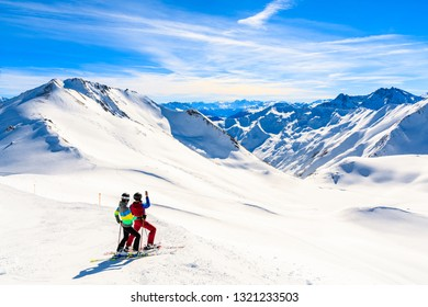 Couple of skiers taking photo on slope with amazing view of Austrian Alps mountains in beautiful winter snow, Serfaus Fiss Ladis, Tirol, Austria