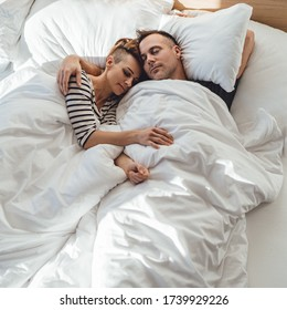 Couple sleeping in the bed