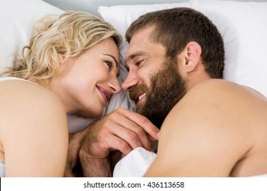 Couple sleeping on bed in bedroom