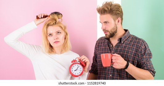 Couple sleepy faces late for work. Woke up too late. I am going late for work. Couple in love overslept morning alarm clock. Woman and man sleepy tousled hair drink morning coffee.