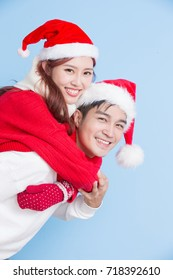 couple smile with merry christmas on the blue background