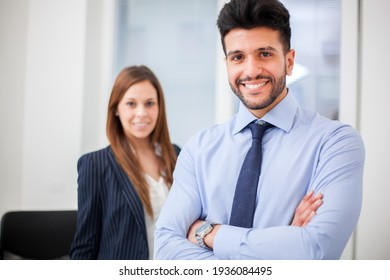 Couple of smiling business people
