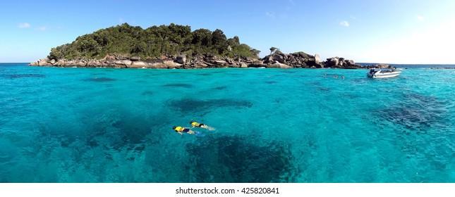 Couple snorkeling in crystal water at similan island, Andaman sea, Phuket, Thailand