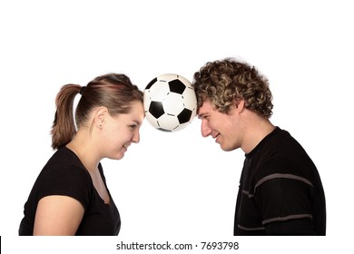 Couple with soccer ball between their heads