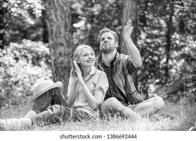 Couple soulmates at romantic date. Romantic couple students enjoy leisure looking upwards observing nature background. Romantic date at green meadow. Couple in love spend leisure in park or forest.