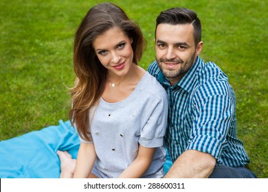 Couple spending great time on blanket in the garden