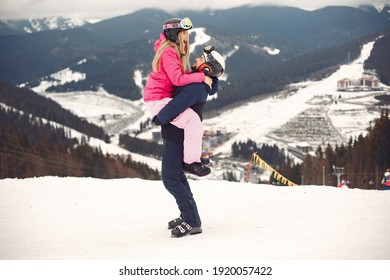 Couple in sport clothes. People spending winter vacation on mountains