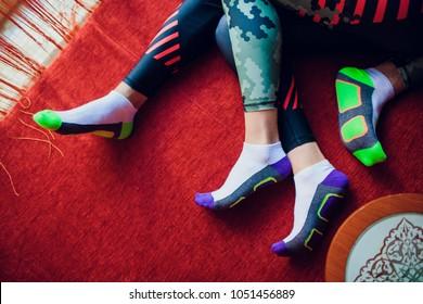couple sport socks man woman lie on the rug