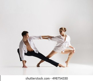 Couple of sporty ballet dancers in art performance