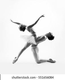 Couple of sporty ballet dancers in a classic performance. Black and white.