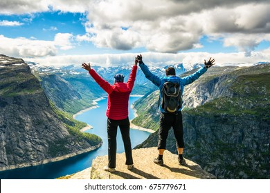 Couple standing against amazing nature view on the way to Trolltunga. Location: Scandinavian Mountains, Norway, Stavanger. Artistic picture. Beauty world. The feeling of complete freedom