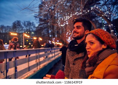 Couple Standing Beside Ice Rink Outdoors
