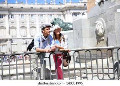 Couple standing in front of Madrid Royal Palace