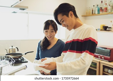 Couple standing in the kitchen