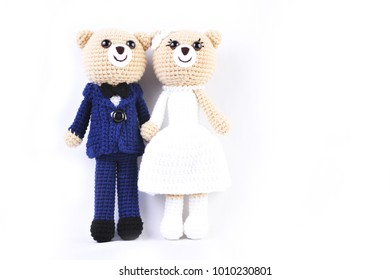 couple of standing light brown teddy bear on white background