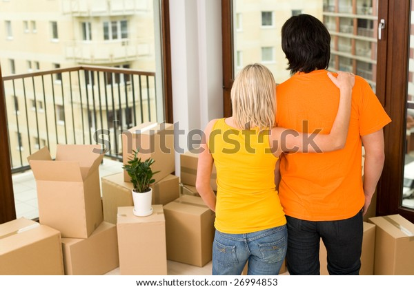 Couple standing in new house