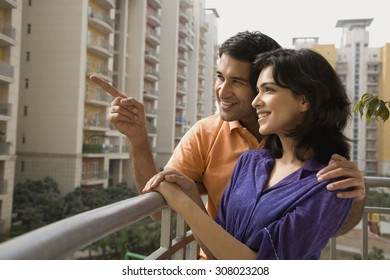 Couple standing on a balcony