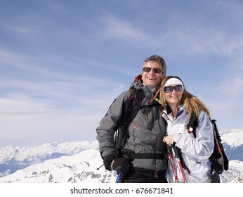 couple standing on mountain top