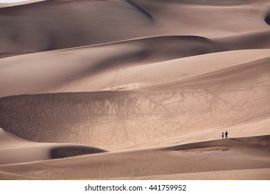 Couple standing on sand dunes at The Great Sand Dunes national park Colorado