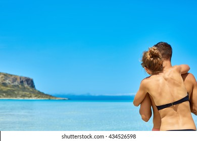 couple standing in the sea on the Balos beach, Crete, Greece