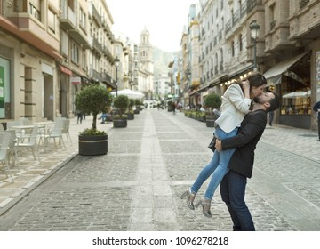 Couple in the street having love time, kiss and hug