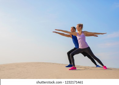 Couple stretching outdoors together