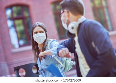 Couple of students in the campus wearing masks due to coronavirus pandemic