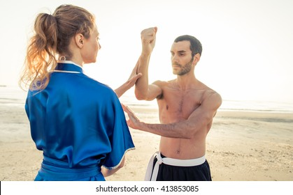 Couple students training martial arts on stock photo edit now couple of students training martial arts on the beach parry and hit in kung fu m4hsunfo