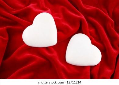 couple of sugar gingerbread hearts over purple velvet