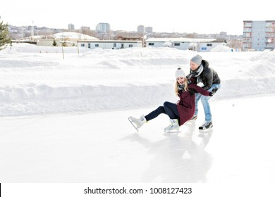 couple in sunny winter nature ice skating